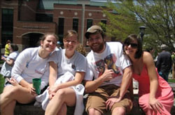 group of graduate students sitting outside