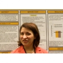Lisa Emery in front of research poster